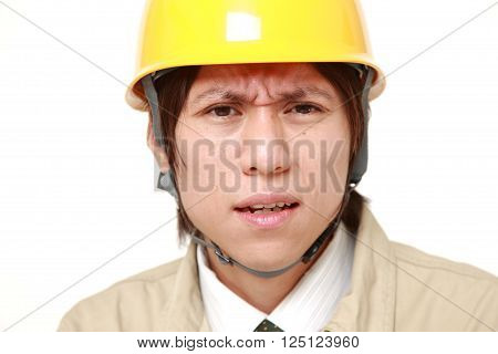 portrait of perplexed construction worker on white background
