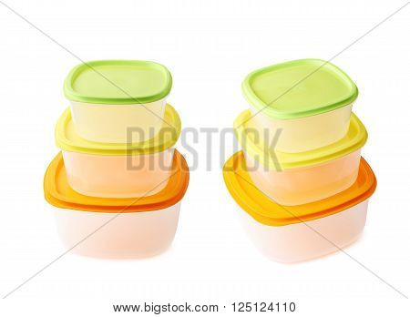 Pyramid pile of colorful plastic food containers, composition isolated over the white background, set collection of two different foreshortenings