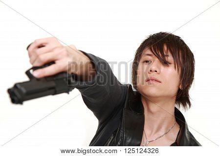 portrait of man with a handgun on white background