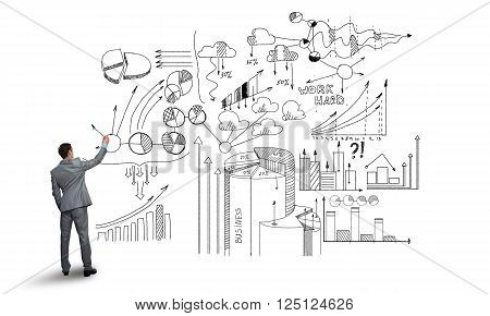 Rear view of businessman isolated on white background writing business strategy sketches