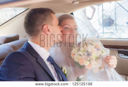 Newlywed Couple Kissing Each Other In car