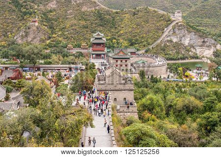 Beijing, China - October 14, 2013: A view of the Great Wall in Beijing, China on a cloudy day. The Visitors are both locals and foreigners.