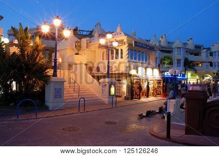 BENALMADENA, SPAIN - JUNE 29, 2008 - Bars and restaurants along the marina promenade at night Benalmadena Malaga Province Andalusia Spain Western Europe, June 29, 2008.
