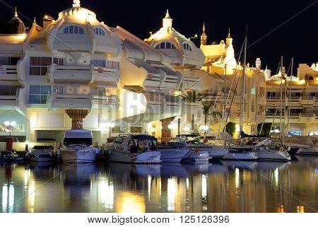 BENALMADENA, SPAIN - JUNE 29, 2008 - Boats and apartments in the marina at night Benalmadena Malaga Province Andalusia Spain Western Europe, June 29, 2008.