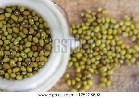 Mung beans in glass jar. Selective focus to emphasize.