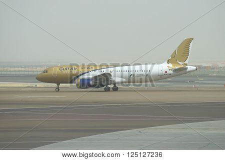 ABU DHABI, UAE - MARCH 10, 2015: Airbus A320-214 (A9C-AM) Gulf Air at the start in Abu Dhabi the early morning
