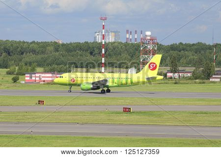 ST. PETERSBURG, RUSSIA - JULY 27, 2015: The plane of the company S7 Siberia Airlines Airbus A319 (VP-BHP) on the runway of the Pulkovo airport