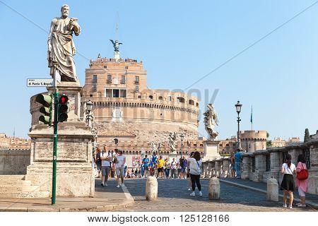 Tourists Walk Near Statues On Saint Angelo Bridge