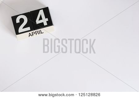 April 24th. Image of april 24 wooden color calendar on white background.  Spring day, empty space for text. World Immunization Week.