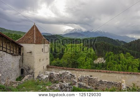 Tower Of Medieval Fortress In Rasnov With Mountains At Background, Transylvania, Brasov, Romania