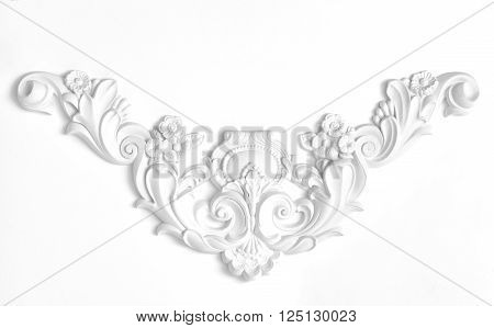 White wall decorated with stucco decorative elements of the Renaissance Baroque.