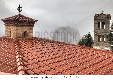 The roof of the monastery on top of a cliff in the monastery complex of Meteora