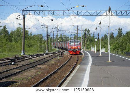 LENINGRAD REGION, RUSSIA - JUNE 08, 2015: Train from Saint Petersburg arrives at the station