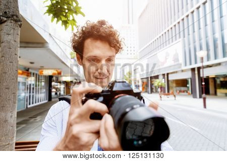 Male photographer taking picture