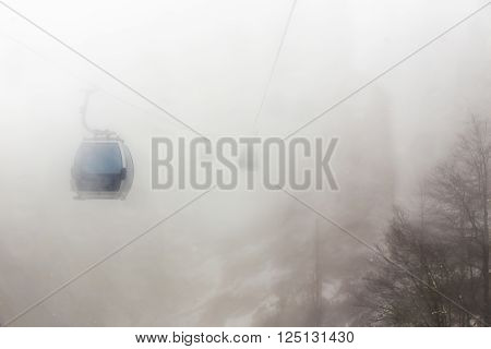 Ski elevator cabin in the mist at mountains bad weather