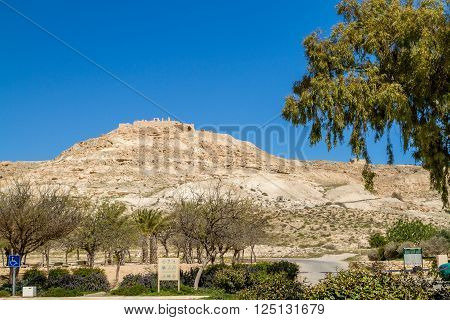 The desert landscape ruins of the ancient city on hill. Avdat Nabatean Town on the ancient spice route in the Negev Desert Israel