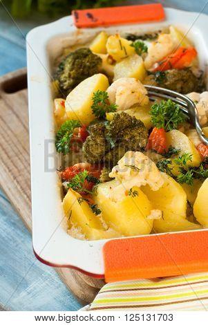 Vegetable casserole of various vegetables with bechamel sauce. Vegetarian dish.
