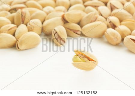 The pistachios on white background. The pistachio background.