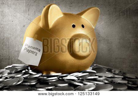 Golden Piggybank With Panama Papers Text
