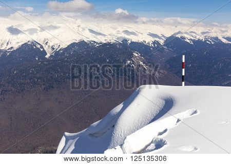 Edge mark on Rosa Peak, scenery top view on snowy Caucasus mountains
