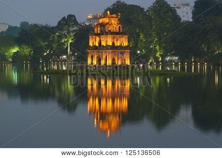 HANOI, VIETNAM - DECEMBER 13, 2015: The tower turtle on Hoan Kiem lake in the evening twilight. Historical landmark of the city Hanoi, Vietnam