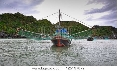 Traditional Vietnamese fishing boats with large nets.