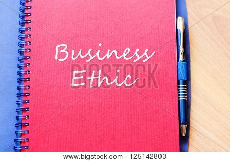 Business ethic text concept write on notebook