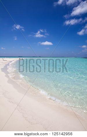 Maldives, white sand and blue water tropical beach