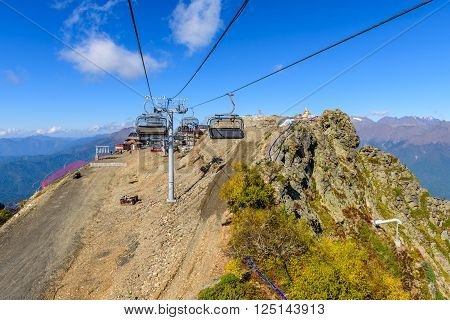 SOCHI, RUSSIA - October 8: People on the cable car in the scenic mountains at the autumn in October 8, 2015 in Sochi, Russia.