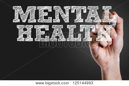 Hand writing the text: Mental Health
