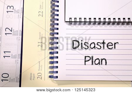 Disaster plan text concept write on notebook