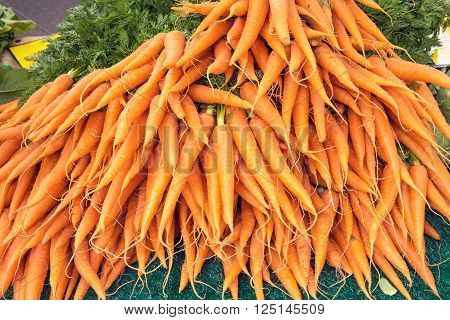 A bunch of carrots for sale at a market