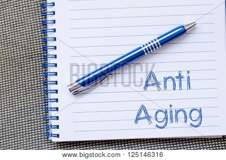 Anti aging text concept write on notebook