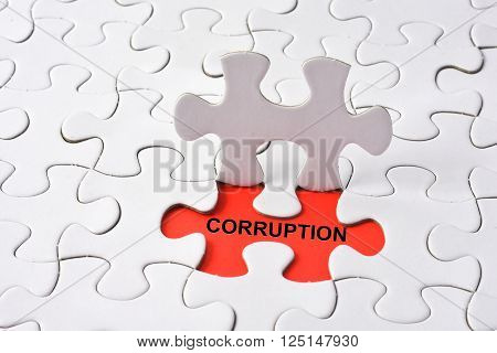 CORRUPTION with missing puzzle on red background