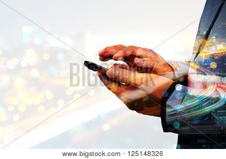 Double Exposure Of Business Man Use Mobile Smartphone With Urban City Scenic And Highway