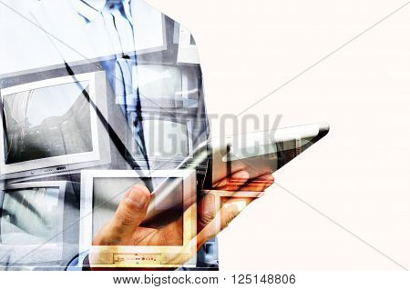 Double Exposure Of Business Man Use Mobile Tablet With Television Display