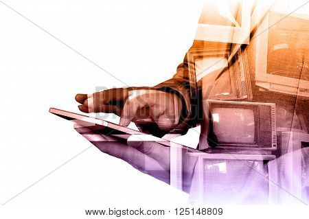 Double exposure of Business Man use Mobile Tablet with Television display as Application Technology Concept