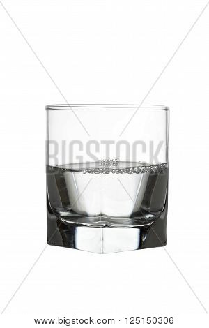 Water in glass with air bubles isolated on white