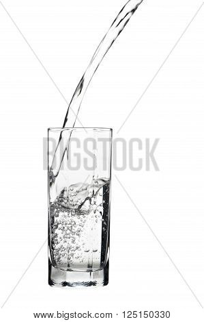 Waterflowing into a glass isolated on white background