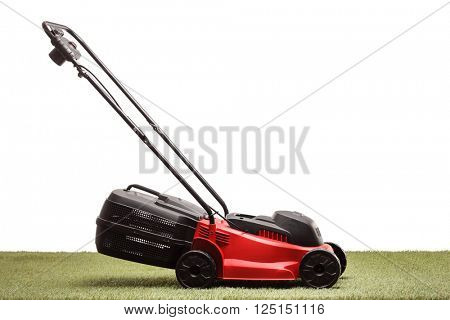 Lawn mower on grass isolated on white background
