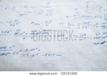 Squared sheet of paper filled with trigonometry math equations and formulas
