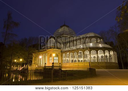 Madrid, Spain - April 8, 2016: Crystal Palace in Retiro Park, Madrid. It is a metal and glass structure. It was built in 1887 on the occasion of the Exhibition of the Philippine Islands