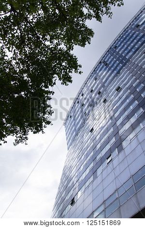 VIENNA, AUSTRIA - MAY 7: Modern buildings in front of Gasometers of Vienna in Austria on 7 May 2012 in Vienna, Austria.