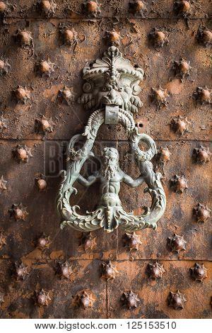 Ancient wooden spiked door detail in Genoa Italy