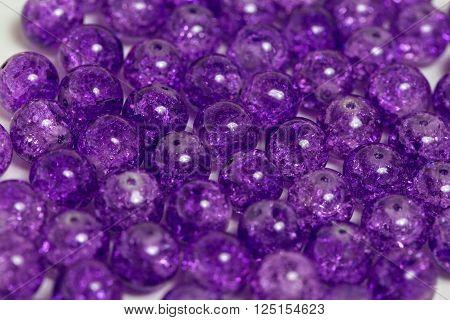 Background of rounded bright purple quartz stones