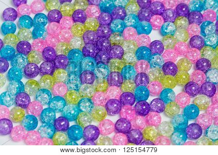 Background of rounded bright colorful quartz stones
