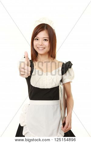 young Japanese woman wearing french maid costume with thumbs up gesture