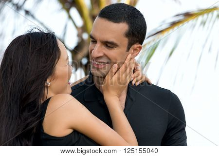 Couple in love outdoor.Stunning sensual outdoor portrait of interracial happy couple. Asian womanCaucasian man