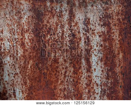 Steel walkway mats sprayed red rust. Iron surface rust