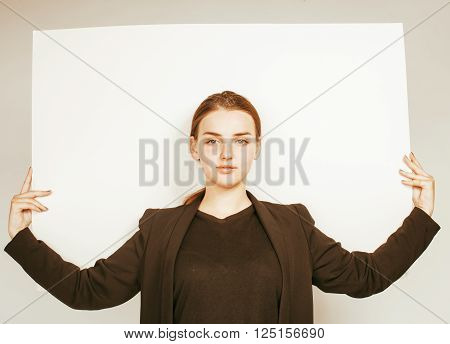 young pretty brunette girl with placard shit copyspace on white background wearing business costume student